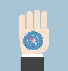 Businessman hand holding a compass that points to vector