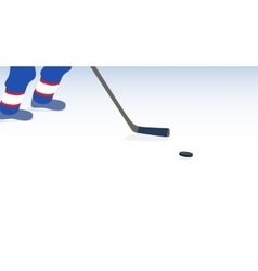 Ice hockey player with stick and puck vector