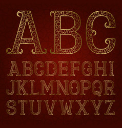 Golden ornamental letters with flourishes on red vector