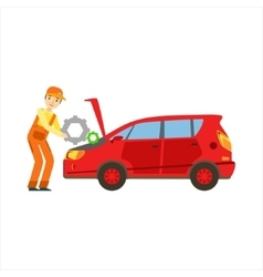 Smiling Mechanic Repairing The Engine In The vector image vector image