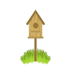 Wooden bird house on grass vector