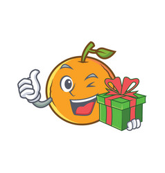 Orange fruit cartoon character with gift vector