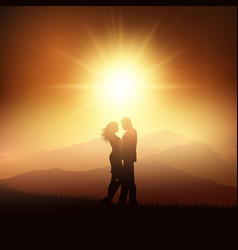 Silhouette of a couple in a sunset landscape vector