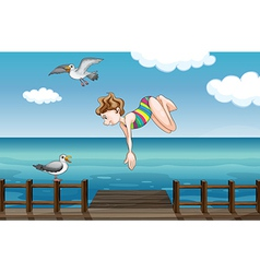 A young girl diving vector image