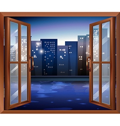 A window across the tall city buildings vector