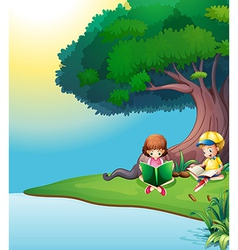 A boy and a girl reading under the tree vector