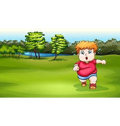 A boy jogging near the river vector
