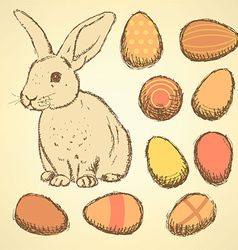 Sketch easter eggs and bunnyset in vintage style vector