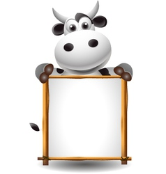 funny cartoon cow with board vector image