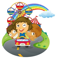 A vehicle with happy kids near the amusement park vector image