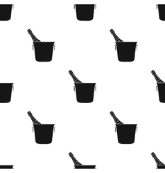Bottle of champagne in an ice bucket icon in black vector