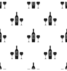 Bottle of red wine with glasses icon in black vector image vector image