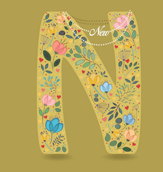 Yellow letter n with floral decor and necklace vector