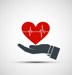 Hand holding a human heart vector image