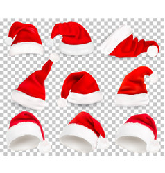 collection of red santa hats on transparent vector image vector image