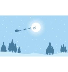 Silhouette of santa with train deer on sky vector