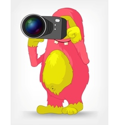 Funny monster photographer vector