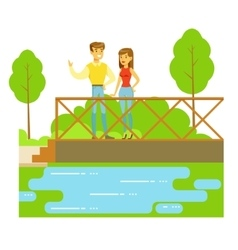 Young couple standing on the bridge watching the vector