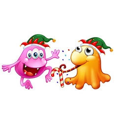 Christmas theme with two monsters at party vector image