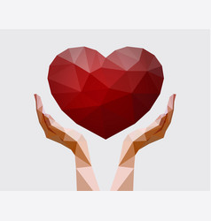 human hands holding polygonal heart vector image