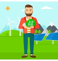 Man holding lightbulb with windmills inside vector