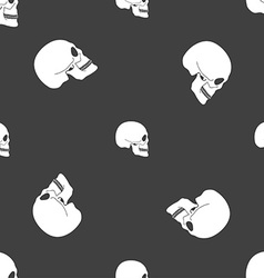 Skull sign seamless pattern on a gray background vector