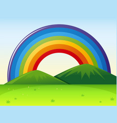 Nature scene with rainbow over the hills vector