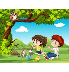 Boy and girl sitting under the tree vector