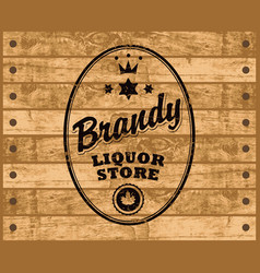 brandy label on wooden background vector image vector image