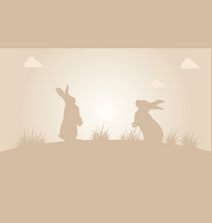 silhouette of easter bunny at sunset vector image vector image