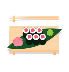 Maki sushi with tuna served on wooden board vector