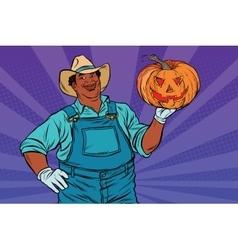 African American farmer with a Halloween pumpkin vector image vector image