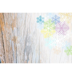 Wooden plank background with colorful snowflake vector