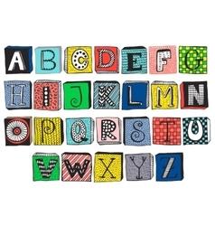 Hand drawn fancy alphabet on blocks vector