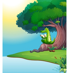 A crocodile reading under the tree vector