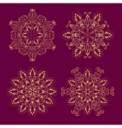 Set from gold floral mandala over purple vector