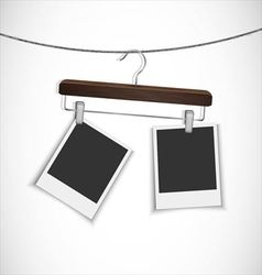 Blank photo frame with clothes hanger vector