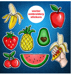 Set of fruits embroidery patch on jeans background vector