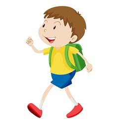 Little boy with schoolbag walking vector image