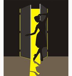 Woman in the doorway vector