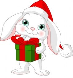 little rabbit with Christmas gift vector image