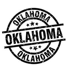 Oklahoma black round grunge stamp vector