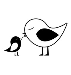 Black silhouette of bird feeding a chick vector