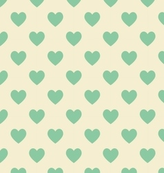 Seamless polka dot yellow pattern with green heart vector