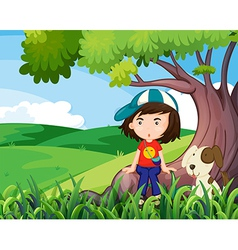 A young girl and her pet under the tree vector image vector image
