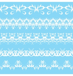 Set of white lace edging ornaments on a blue backg vector