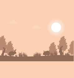 silhouette of bunny at sunset landscape vector image