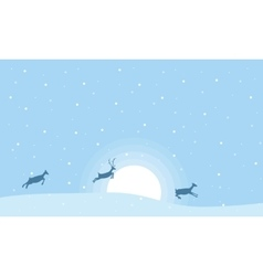 Christmas landscape reindeer on the hill vector