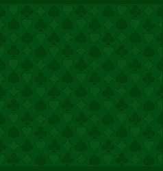 Seamless pattern with playing card suits on green vector