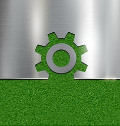 Contour gear on grass background vector
